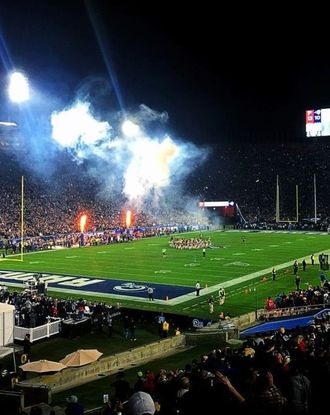 Football field lit up at night at the LA Memorial Coliseum