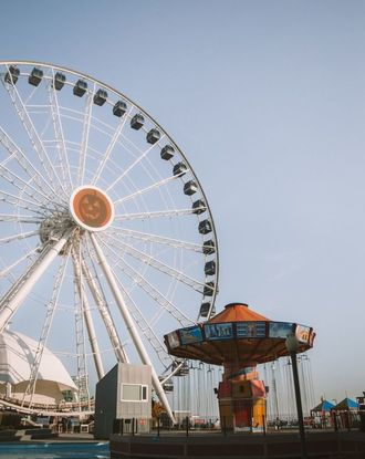 Front view of a merry-go-round and big wheel at the Navy Pier