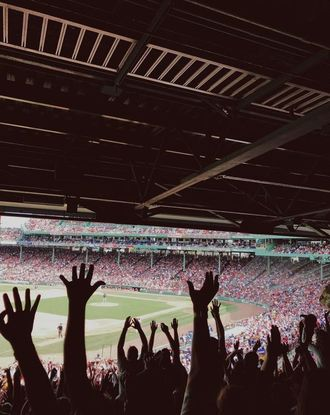 Crowd cheering during a game at Fenway Park