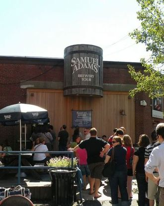 Crowd lined up to get into Samuel Adams Brewery on a sunny day