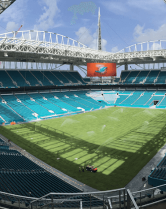 Hard Rock Stadium with open roof on a sunny day