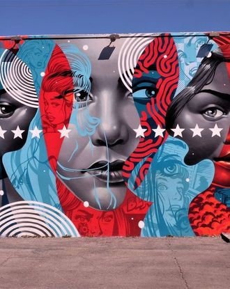 Black, white, blue, and red graffiti of three women in Wynwood Wall