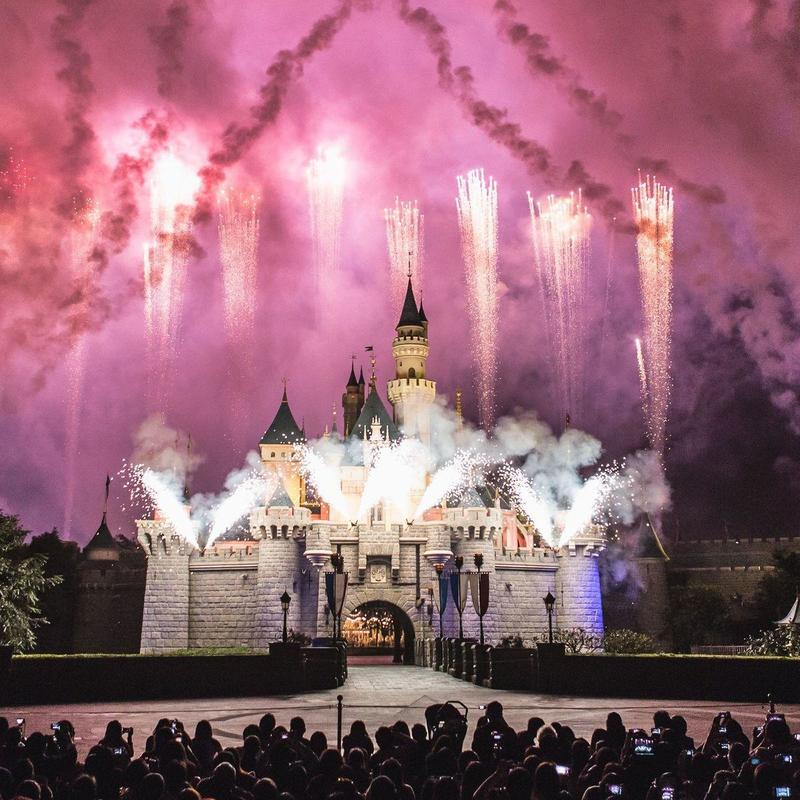 Fireworks going off near Disney Castle in Disneyland