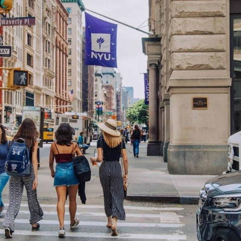 Students walking streets of New York to NYU in the summer