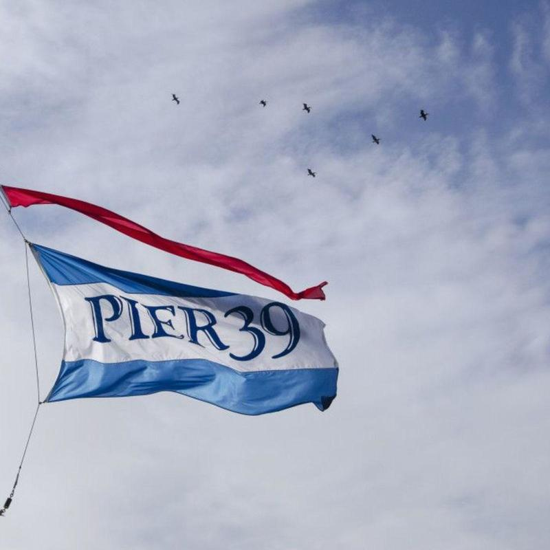 Pier 39 flag flying in the wind