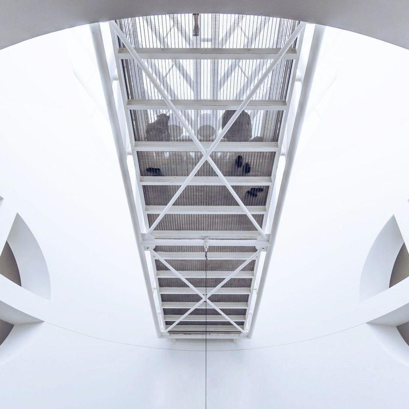 Worm's eye photography of white concrete building