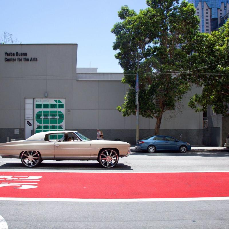 Silver coupe in front of Yerba Buena building