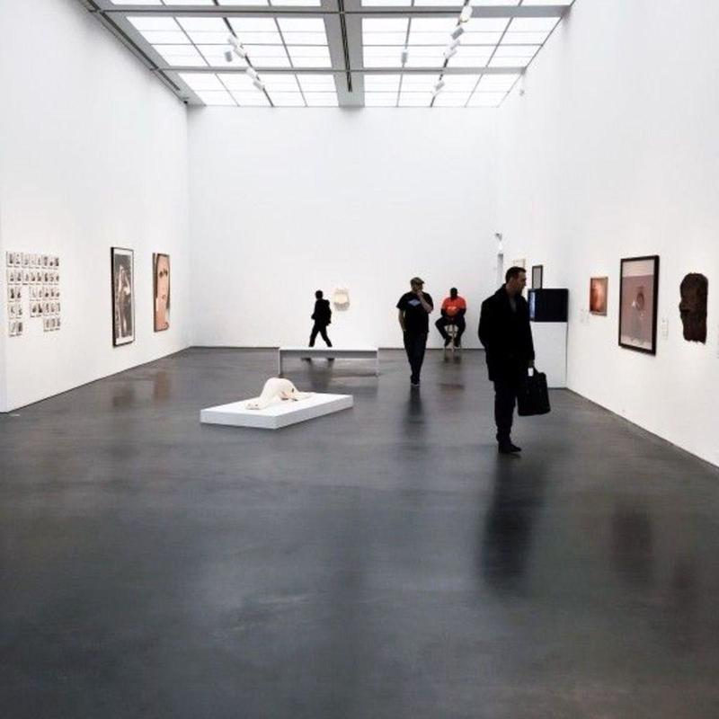 People admiring art in a white room at the Art Institute of Chicago