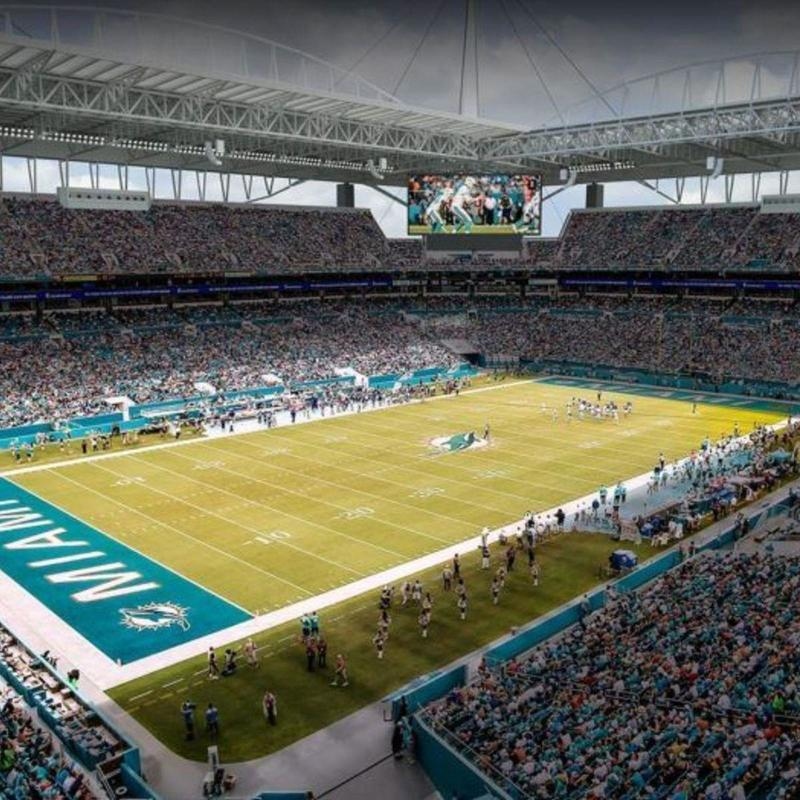 Hard Rock Stadium with roof open and light come into the field