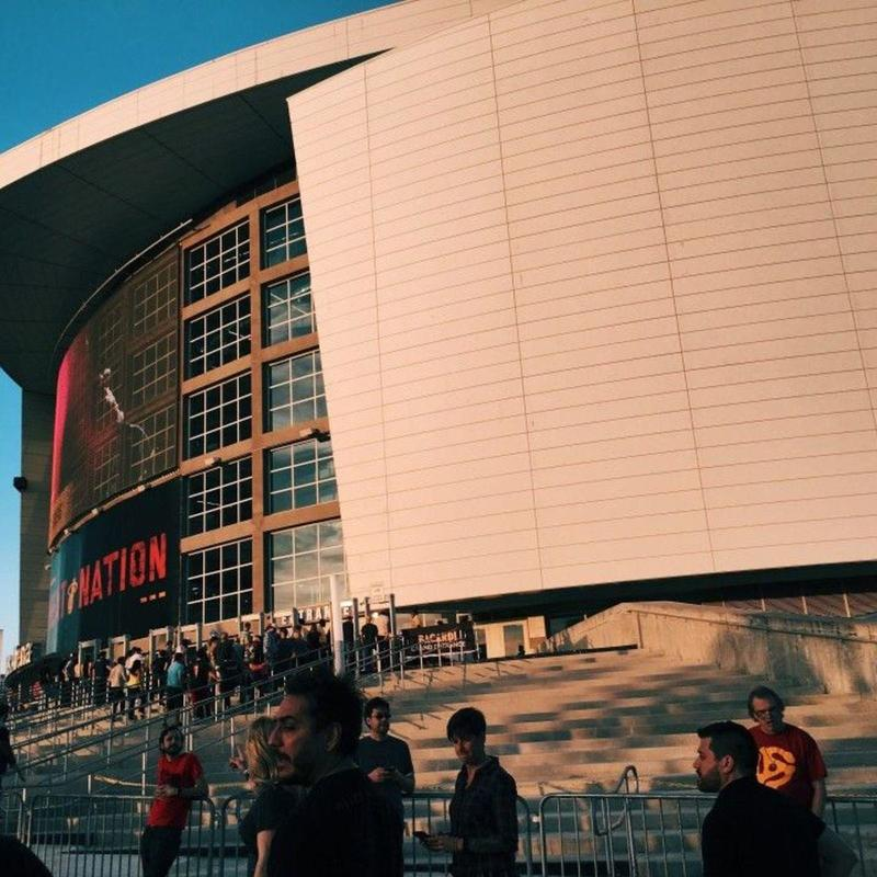 Sunlight hitting the side of American Airlines Arena at dusk
